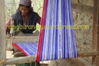 A Himachali woman weaving a Pattoo